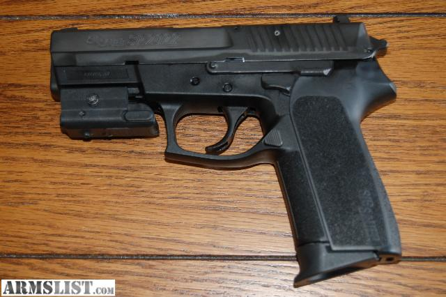 9 mm Pistols With Laser http://www.armslist.com/posts/145785/fayetteville-arkansas-handguns-for-sale-trade--sig-sp2022-9mm-w--laser
