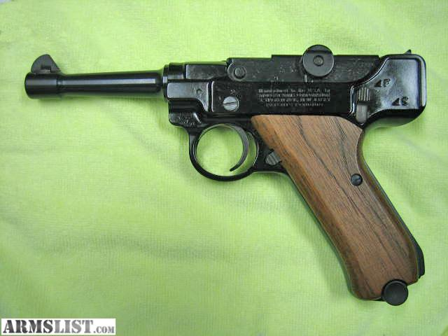 Near mint example of a stoeger 22 caliber luger has 2nd magazine