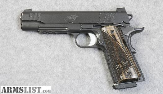 This is Kimber SIS Custom in 45 acp in very good condition with only a