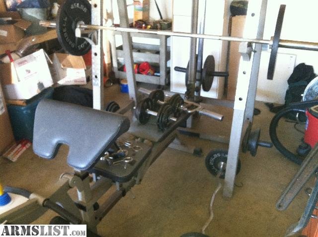 ARMSLIST - For Sale/Trade: Home gym, Weight bench set and pully system