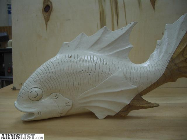 Wood tree house fish carvings for sale