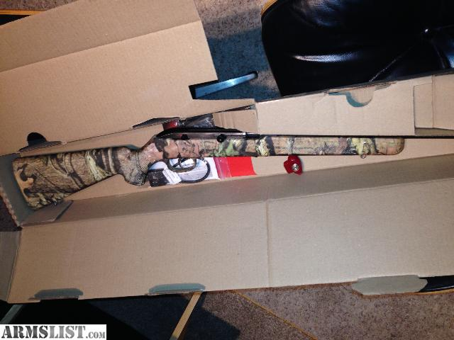 Brand new in the box never fired. Savage Model 64 FULL CAMO .22 rifle