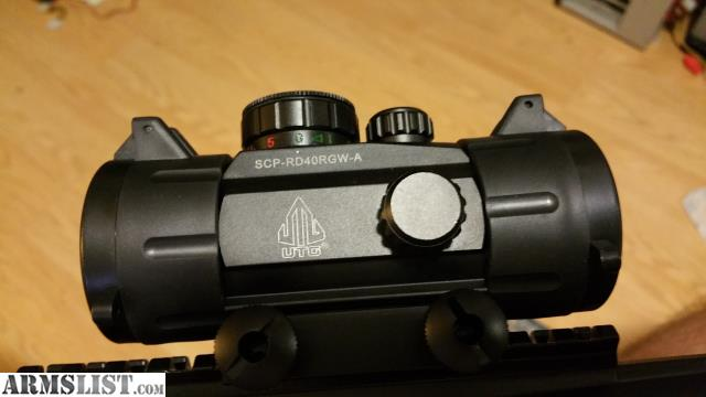 Less than 100 rounds through it includes utg red dot buyer to pay